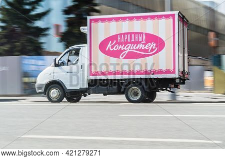 Small Cargo Van Gaz Gazelle With Inscription In Russian Narodny Konditer On The Car Body. Fast Movin