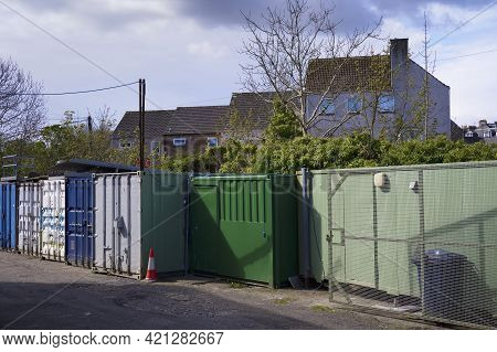 Green Storage Containers Next To Council House Estate