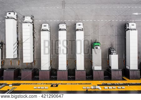 Top View Of Trucks Loading In The Distribution Hub