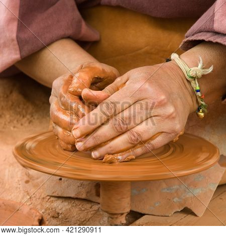 Sculpting Clay; Close Up Of Woman´s Hands Working On A Potters Wheel. Spain