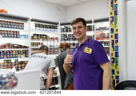 Russia, May 15, 2021: Seller And Buyer In The Store-the Concept Of Service In The Retail Business.