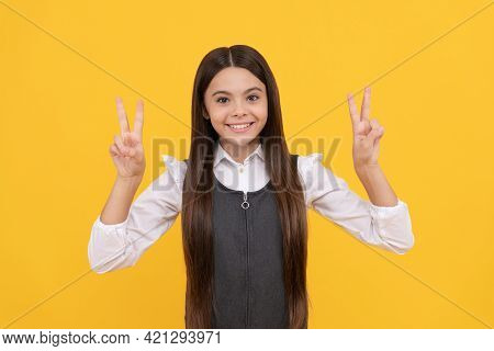 Victory In Learning. Happy Kid Give Double V Signs. Pupil Achievement. Academic Achievement