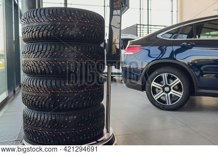 4 New Tires That Change Tires In The Auto Repair Service Center, Blurred Background, The Background