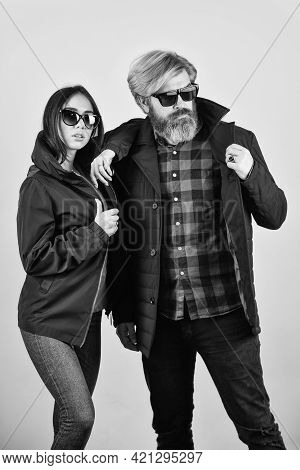 Trendy Couple In Sunglasses. Outdoor Autumn Outfit. Stylish Couple Of Models In Autumn Outfits Posin