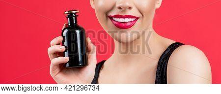 Beautiful Girl Using Perfume. Woman With Bottle Of Perfume. Woman Presents Perfumes Fragrance. Woman