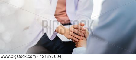 Close Up Hand Of Asian Woman Professional Psychologist Doctor Giving The Consult To Man Patients In