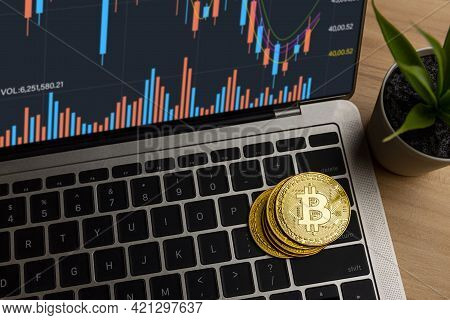 Close Up Bitcoin On Laptop On Table At Home, Cryptocurrency Profit And Income From Investing In Stoc