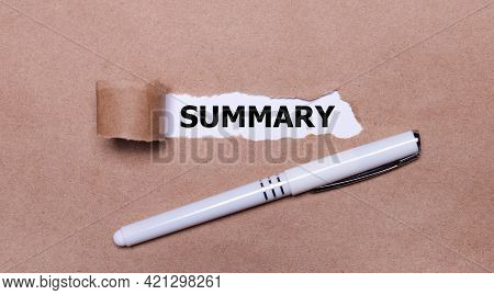 On Kraft Paper, A White Pen And A White Strip Of Paper With The Text Summary.