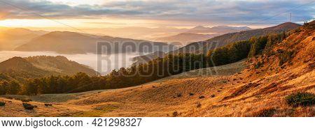 Autumn Morning Mountain Panoramic View With Sunbeams Through Haze And Low Clouds , Carpathians, Ukra
