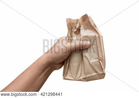Wrapped Paper Brown Bag In Hand, Delivery Foods And Carry Concept, Hand Holding A Carry Brown Paper