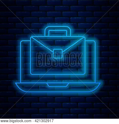 Glowing Neon Line Online Working Icon Isolated On Brick Wall Background. Freelancer Man Working On L