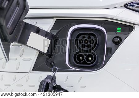 Charge Port On An Electric Car, Ev Charging Port On Electric Car.  Electronic Car Charging Devise Pu