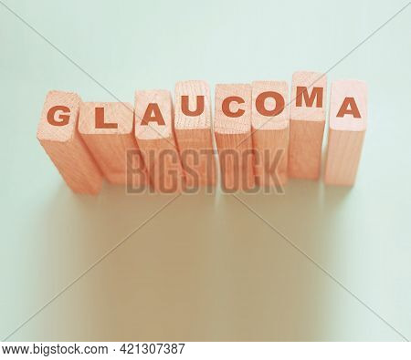 Glaucoma Word Made With Wooden Blocks, Eye Healthcare Medical Concept.