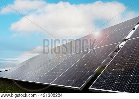 Solar Panels Under The Rays Of The Sun And A Blue Sky. Concept Of Energy Alone, Eco-sustainable Ener