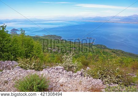 Beautiful Blue Lake Surrounded By Mountains, Mediterranean Landscape On A Sunny Spring Day. Skadar L