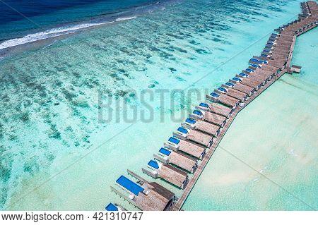 Tropical Summer Beach In The Maldives. Luxury Water Villas In Ocean Lagoon, Amazing Turquoise Sea Wa