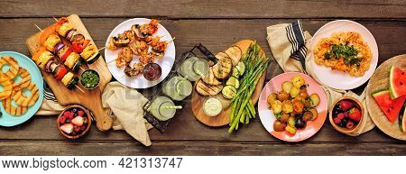 Healthy Plant Based Summer Bbq Table Scene. Overhead View On A Dark Wood Banner Background. Grilled