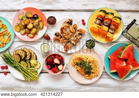Healthy Plant Based Summer Bbq Table Scene. Top View On A White Wood Background. Fruit, Grilled Vege