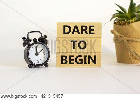 Dare To Begin Symbol. Wooden Blocks With Words 'dare To Begin'. Beautiful White Background, Black Al