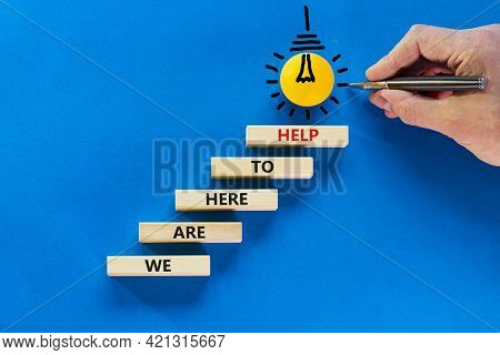 Support Symbol. Wooden Blocks With Words 'we Are Here To Help'. Businessman Hand. Light Bulb Icon Fr