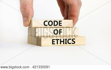 Code Of Ethics Symbol. Concept Words 'code Of Ethics' On Wooden Blocks On A Beautiful White Backgrou