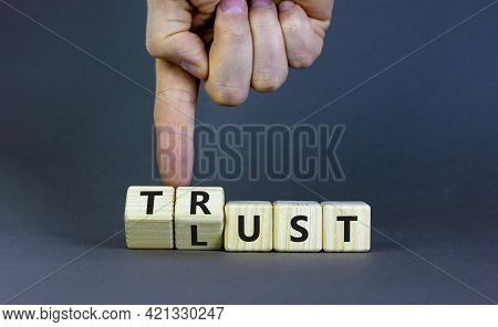 Lust Or Trust Symbol. Businessman Turns Wooden Cubes And Changes The Words 'lust' To 'trust'. Beauti