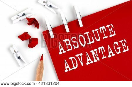 Absolute Advantage Text On Red Paper With Office Tools On The White Background