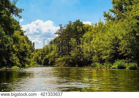 Oskol River, Belgorod Region, Russia. Summer Calm River Landscape. Sunny River Surface With Banks Of