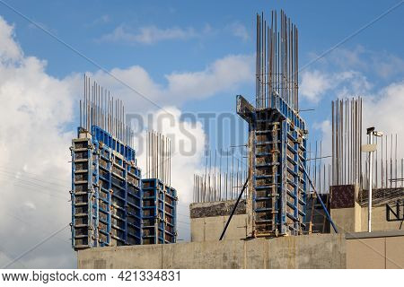 Construction Of Monolithic Walls At A Construction Site. Steel Formwork With Reinforcement, Against