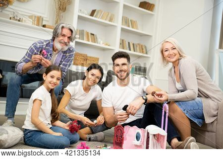 Portrait Of Big Happy Multigenerational Family Father Mother And Grandparents Together With Cute Lit