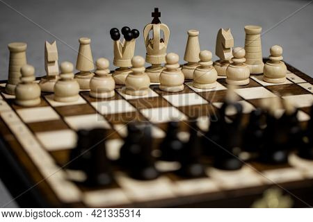 Wooden Chess Pieces On Board, Arranged In Incorrect Initial Position Selective Focus. White King Is