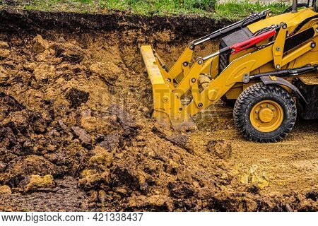 Bulldozer Planning And Cutting Clay Ground At Earthmoving Works In Construction Site Quarry