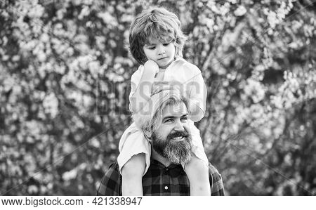 Dad And Son. Little Son. Spring Walk. Fatherhood. Happy Family. Fathers Day. Little Boy And Father I