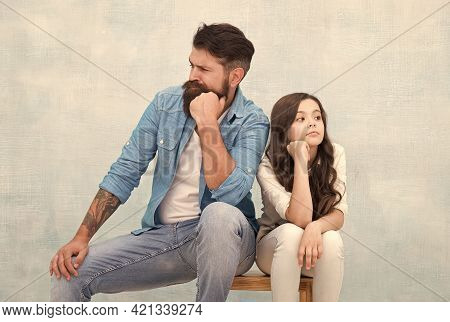 Together Is Our Favorite Place To Be. Serious Daughter And Dad Sit On Stool. Father Child Relations.