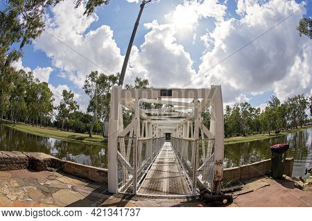 Clermont, Queensland, Australia - May 2021: Bridge Over A Creek With Landscaped Gardens, Curved By F