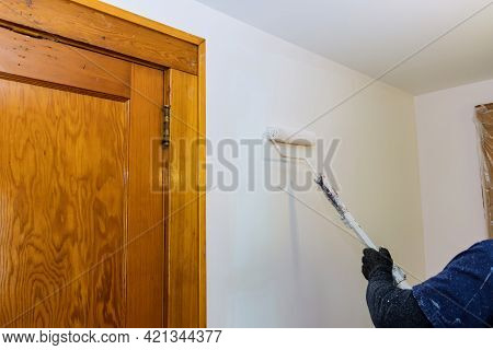 Worker Painting Wall In Room, Apartment Renovation, Repair Home A Paint Roller