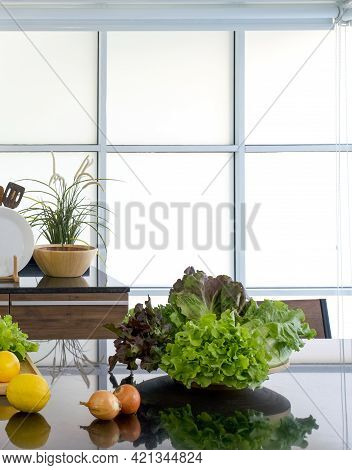 A Bowl Of Fresh Vegetables Place On Black Shiny Granite Kitchen Countertop. Morning Atmosphere In A