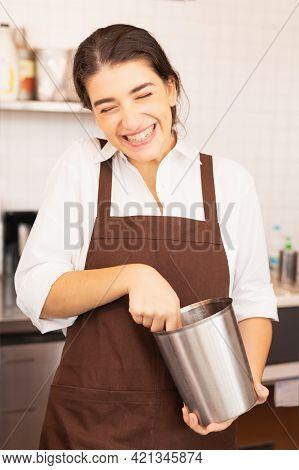 Beautiful Caucasian Barista Woman Fun On Scooping Coffee Beans From Coffee Equipment Into Coffee Bea