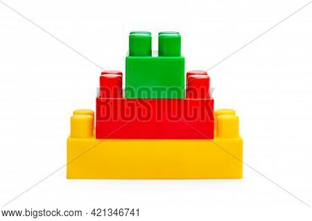 Pyramid Of Colored Toy Bricks On White.