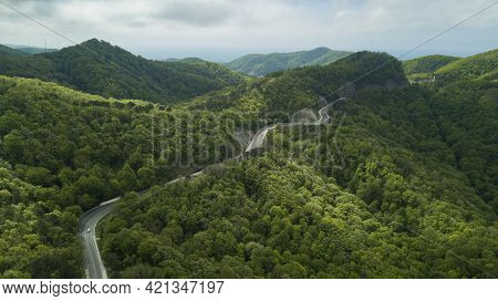 Mountain Winding Zig Zag Road. Top Aerial View: Cars Driving On Road From Above.