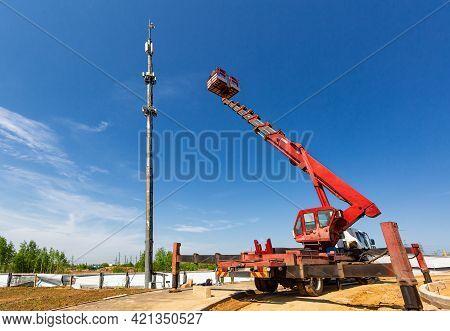 An Aerial Work Platform, Also Known As An Aerial Device, Elevating Work Platform, Cherry Picker, Buc