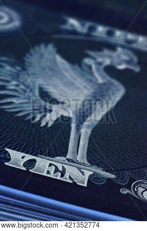 Fragment Of A Japanese 10,000 Yen Bill With A Phoenix Bird. Macro. Dark Vertical Ominous Illustratio