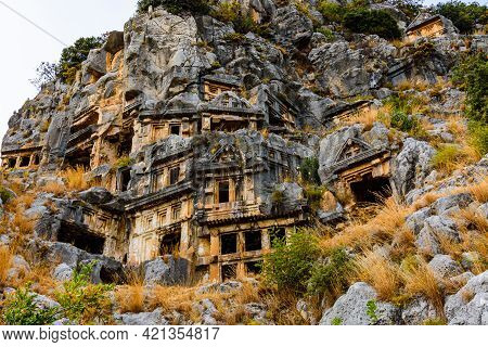 Ruins Of Ancient Lycian Rock Tombs In Town Demre. Ancient Myra City. Antalya Province, Turkey