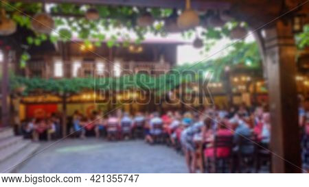 Blurred Background With Bokeh Elements In A Creative Plot On The Theme Of Holiday, Evening Feast And