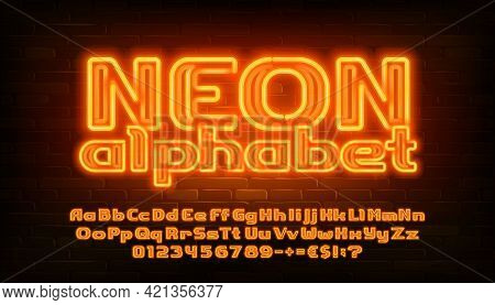 Neon Alphabet Font. Yellow Neon Light Bold Letters, Numbers And Punctuation. Uppercase And Lowercase