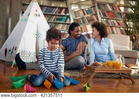 Happy family enjoying at home in a relaxed atmosphere together. Family, together, love, playtime