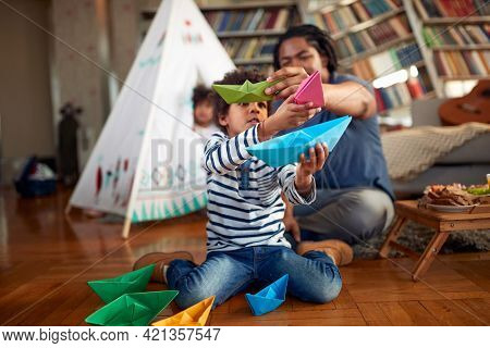 Little boy playing with his father at home together. Family, together, love, playtime