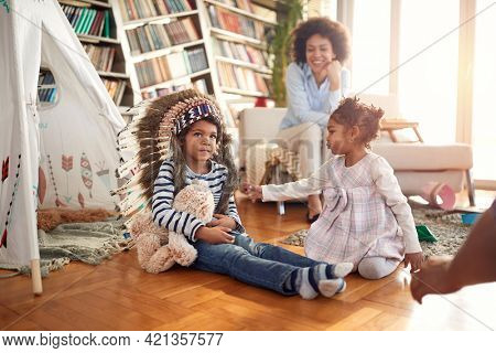 Kids spending a quality time with their Mom in a family atmosphere at home together. Family, together, love, playtime