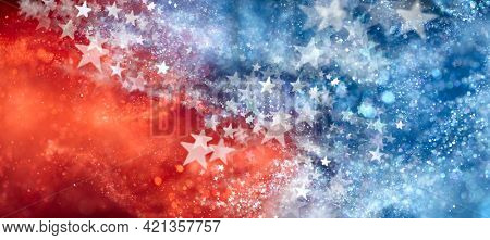 Red, white, and blue abstract background with sparkling stars. USA background wallpaper for 4th of July, Memorial Day, Veteran's Day, or other patriotic celebration.