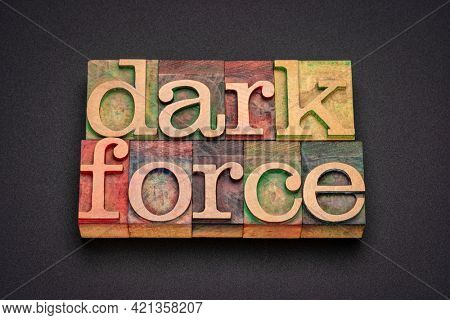 dark force - word abstract in vintage letterpress wood type against black acrylic background